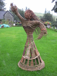 dancing lady woven from willow by Beryl Smith