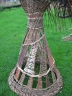 detail of base of woven willow dancing lady by Beryl Smith